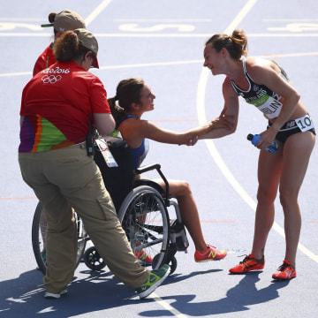 Image: Abbey D'Agostino (USA) of USA thanks Nikki Hamblin (NZL) of New Zealand after finishing the race.