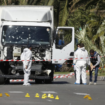 Image: Investigators examine truck used in Nice attack