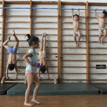 Image: Young gymnasts take part in a training session for four to seven-year-olds in 2010