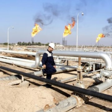 A worker walks at Nahr Bin Umar oil field, north of Basra
