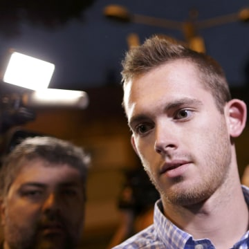 Image: U.S. Olympic swimmer  Gunnar Bentz leaves a police station after being questioned in Rio de Janeiro