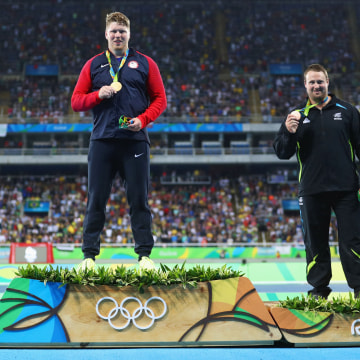 Image: Silver medalist, Joe Kovacs, gold medalist, Ryan Crouserand bronze medalist, Tomas Walsh of New Zealand