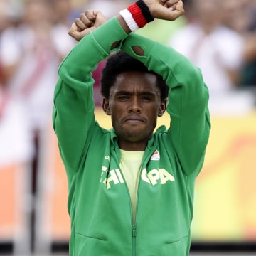Image: Silver medalist Feyisa Lilesa repeats his 'X' gesture at the medal ceremony in Rio late Sunday.