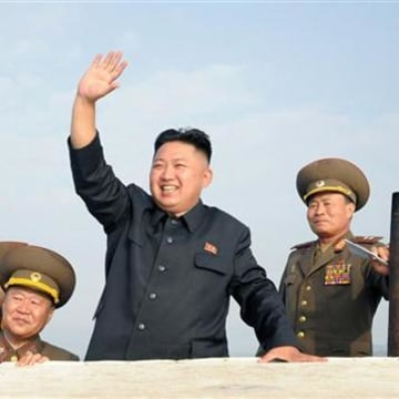 North Korean leader Kim Jong-Un waves as he visits military units on islands in the most southwest of Pyongyang