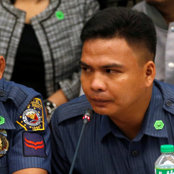 Image: Policemen accused of killing a couple during an illegal drugs raid testify at a Senate hearing in Manila, Tuesday.