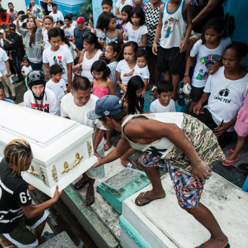 Image: Relatives mourn as the casket of an alleged drug peddler and victim of an extrajudicial killing is laid to rest Monday in Manila, Philippines.