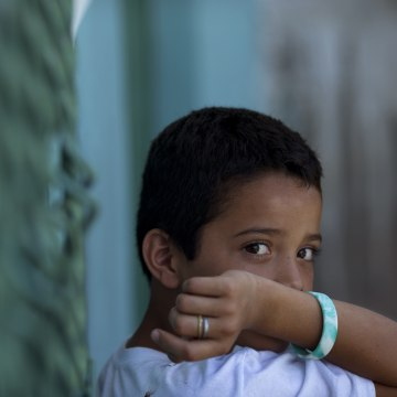 Edwin Lemus, 10, from El Salvador, sits in the men's section of a shelter providing temporary refuge for migrants.