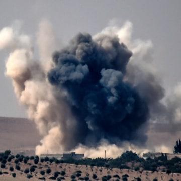 Image: Smoke billows into the sky