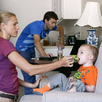 Image: Russian Olympian couple Yuliya and Vitaly Stepanovs with their son after an interview with Reuters