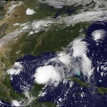 Image: Handout photo of satellite image of two tropical depressions over the Gulf of Mexico and along the Carolina coast