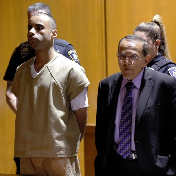 Image: Oscar Morel, accused of fatally shooting a Muslim cleric and his assistant, appears in Queens Criminal Court in Queens, New York