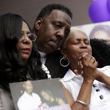Image: The mother of Nykea Aldridge is embraced during a vigil for her daughter