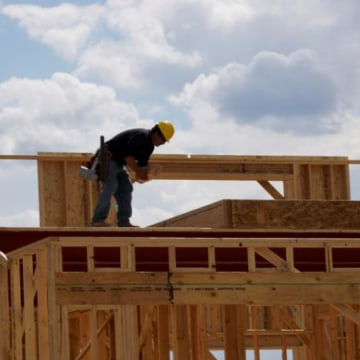 Workers construct a new home in Leyden Rock in Arvada, Colorado