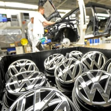 Emblems of VW Golf VII car are pictured in a production line at the plant of German carmaker Volkswagen in Wolfsburg