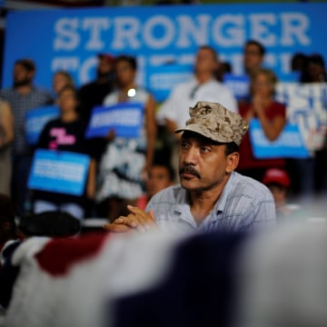 Image: Former Marine Kenny la Cruz listens as U.S. Democratic presidential nominee Hillary Clinton speaks at a campaign Voter Registration Rally at the University of South Florida in Tampa