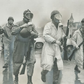 Saving in to crush riot; National Guardsmen wearing gas masks prepare to storm Cellblock D; the stro