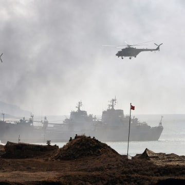 Image: Russia's navy ships and helicopters take part in a military exercise in Crimea.