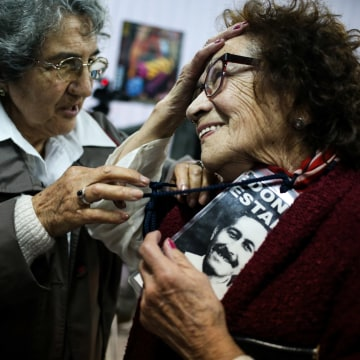 "In this Sept. 5, 2016 photo, Violeta Zuniga, 83, left, and Martha Perez, 80, talk after a performance of ""Cueca Sola"" at a school in Santiago, Chile."