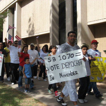Students walked out of high school to protest the signing of SB 1070 into law at the Arizona State Capital in 2010.