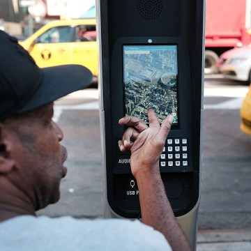 Image: Homeless New Yorkers Use WiFi Kiosks To Stay Connected