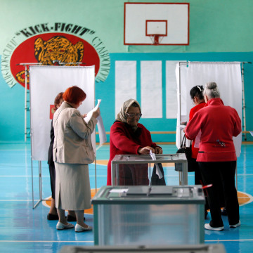 Image: People visit polling station during parliamentary election in Stavropol