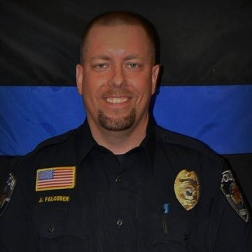 IMAGE: Avon, Minn., police Officer Jason Falconer