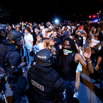 Charlotte, N.C., faces aftermath of protests ignited by fatal police shooting; 12 officers injured