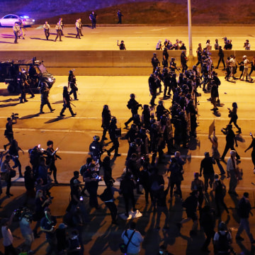 Image: Riot police push protesters off the highway during another night of protests over the police shooting of Keith Scott in Charlotte