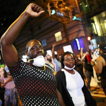 Image: Protesters walk in the streets downtown during another night of protests over the police shooting of Keith Scott in Charlotte