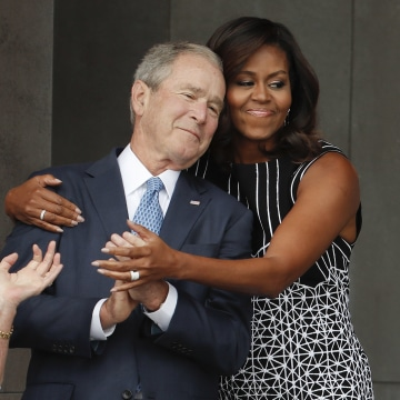 First lady michelle obama hugs former president george w bush during