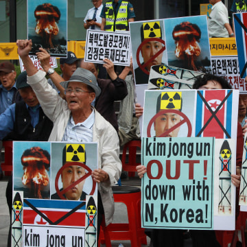Image: South Korean protesters with defaced pictures of North Korean leader Kim Jong Un during a rally