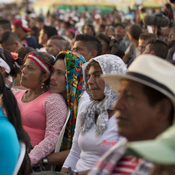 Rebels of the Revolutionary Armed Forces of Colombia, FARC, watch live images of government and FARC leaders signing a peace agreement to end more than five decades of conflict, during an event organized by the FARC in the Yari Plains of southern Colombia
