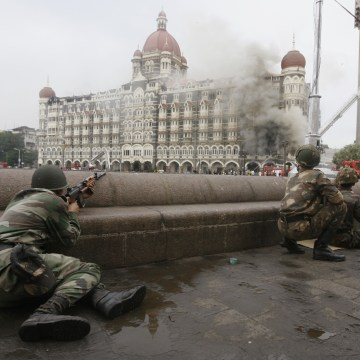 Image: Indian army soldiers take position during a gun battle at Taj Mahal hotel in Mumbai