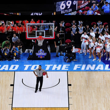 Image: An official waits for play to resume during the second round of the NCAA Men's Basketball Tournament at PNC Arena