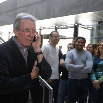 Image: French scientist Jean-Pierre Sauvage speaks on the phone after learning he won the Chemistry Nobel Prize with J. Fraser Stoddart and Bernard Feringa.aks on the phone at the University of Strasbourg
