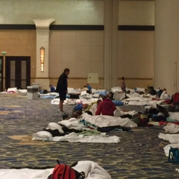 Because of the Hurricane, guests at the Atlantis Resort in Nassau were placed in conference rooms to spend the night.