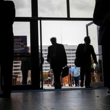 People enter the Nassau County Mega Job Fair at Nassau Veterans Memorial Coliseum in Uniondale, New York