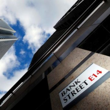 A sign for Bank Street and high rise offices are seen in the financial district in Canary Wharf in London