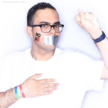 Louis Ortiz participating in the NOH8 campaign.
