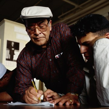 Math Teacher Jaime Escalante Assisting Student