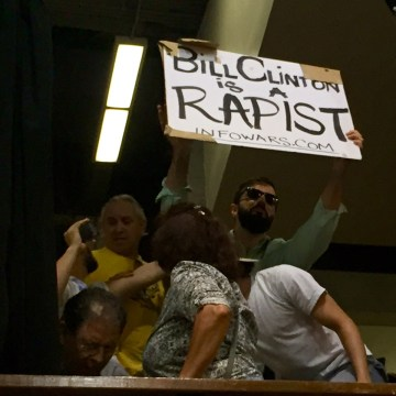 Image: A protester interrupts Hillary Clinton during a Tuesday night rally in Miami, Florida.