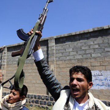 Image: Armed Houthis brandish weapons in Sanaa, Yemen, on Oct. 2.