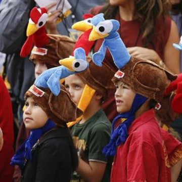 "Children wear promotional turkey hats at world premiere of the animated film ""Free Birds"" in Los Angeles"