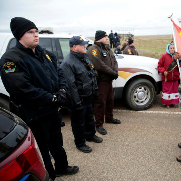 Image: Dakota Access Pipeline protesters square off against police between the Standing Rock Reservation and the pipeline route outside the little town of Saint Anthony