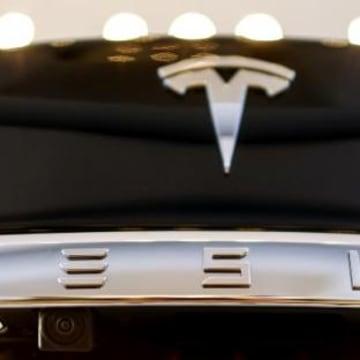 A Tesla logo adorns a 'Model S' car in the dealership in Berlin