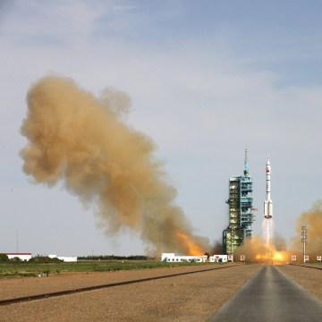 Image: The Long March 2-F rocket loaded with Shenzhou-10 manned spacecraft carrying Chinese astronauts Nie Haisheng, Zhang Xiaoguang and Wang Yaping lifts off from the launch pad in the Jiuquan Satellite Launch Center