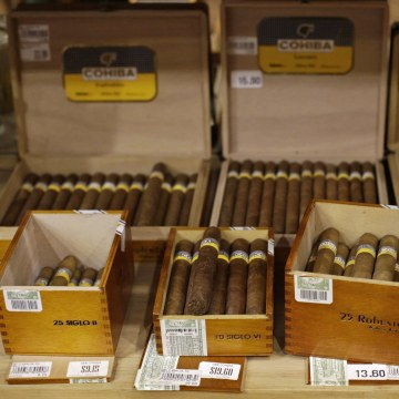 Image: Cuban cigars for sale are on display at a hotel in Havana