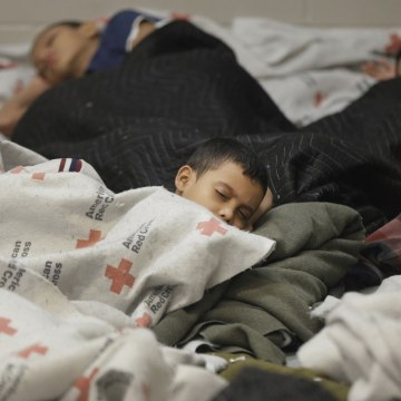 Image: Detainees sleep in a holding cell at a U.S. Customs and Border Protection processing facility