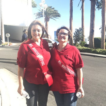 """Protesters wearing """"Ms. Keeping"""" sashes out front of the Trump International Hotel in Las Vegas."""