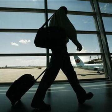An Air Canada passenger walks to catch his plane